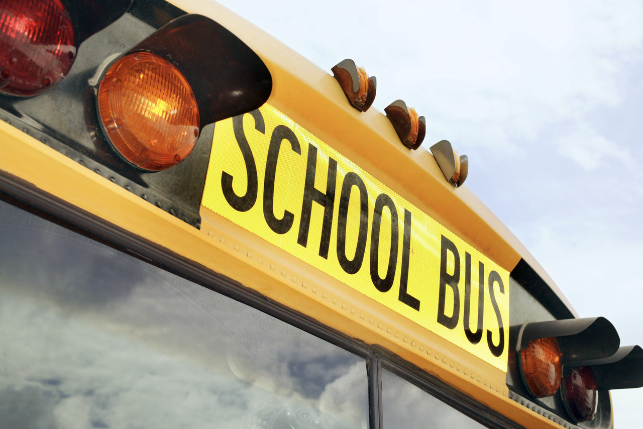 Clover, South Carolina, USA --- Flashing Lights and Sign on School Bus --- Image by © Royalty-Free/Corbis