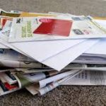 disorganized pile of mail. Get help organized your mail